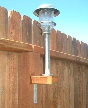"""Great idea for a large back yard: Use your solar lights. They aren't just for the ground! Take a 2x4 and cut them into squares to fit the existing fence posts. Using galvanized screws - not nails - to screw a """"L"""" bracket to the underneath base. Then on top, screw on the stake."""