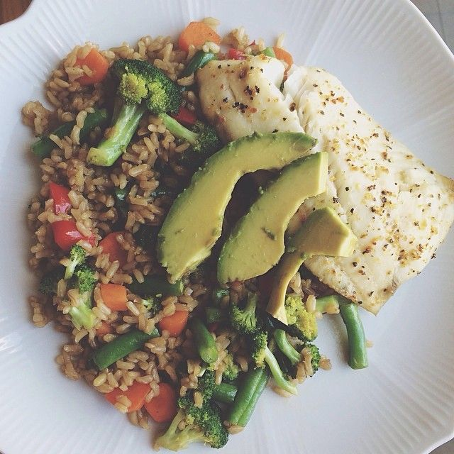 Baked lemon pepper tilapia on a bed of veggie fried brown rice topped ...