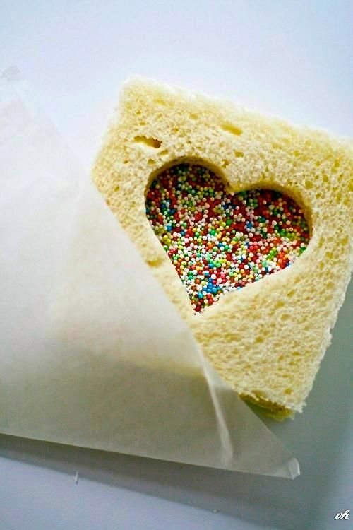 LOVE this idea for Tori's Valentine's Day sandwich in her lunchbox!!! Heart shaped cookie cutter, pb&j and sprinkles...they will stick perfect! For her snacks...everything pink, red and heart shaped haha!!!