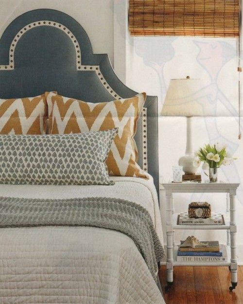 upholstered headboard, chevron pillows