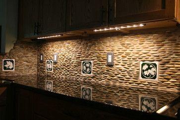 love mix of art tile with river rock for backsplash would use
