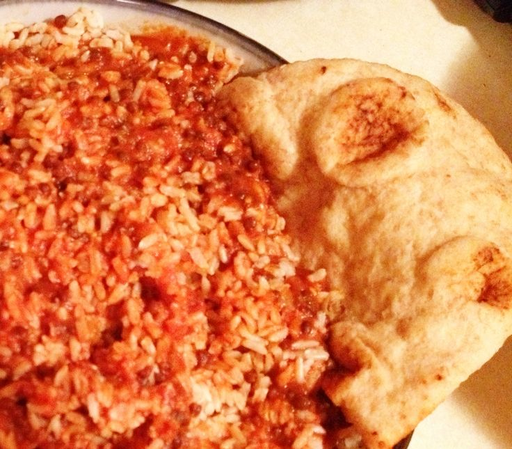 Red Curry Lentils over brown rice served with whole grain garlic Naan ...