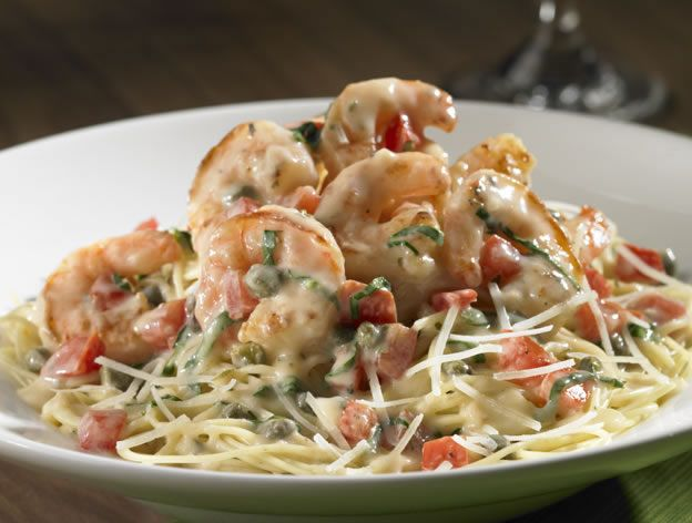 butter sauce with tomatoes, basil, and capers. Served over angel hair ...