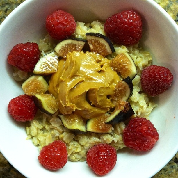 Oatmeal topped with coconut peanut butter + figs, raspberries, and a ...