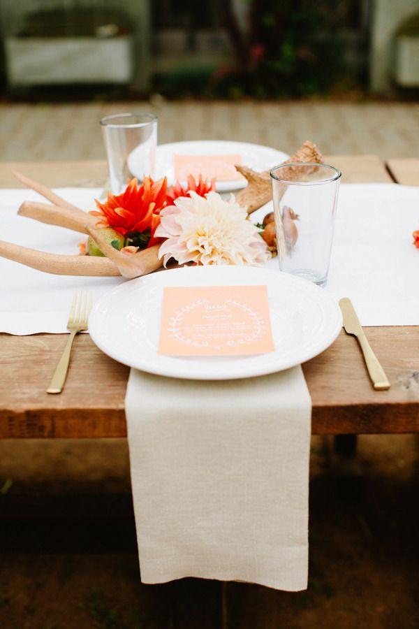 Biergarten Inspired wedding tablescape wood tabletop, gold flatware and peach and orange fowers
