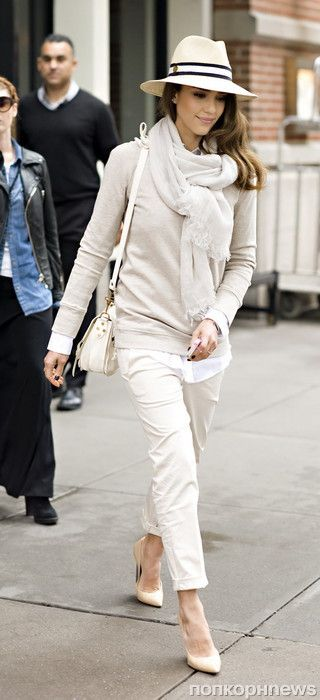 white pants white sweater hat and purse