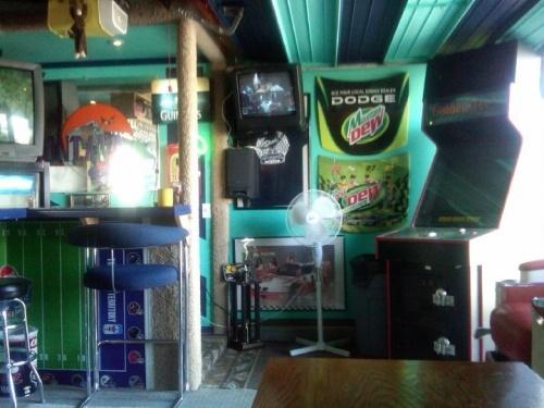 Man Cave Kingdom : Man cave bar inside a garage multi themed with football