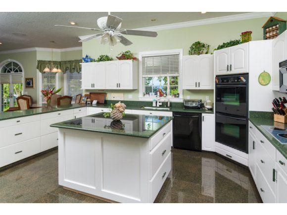 Loving the emerald green granite counters! Also granite kitchen