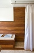 teak wood shower wall and tub surround