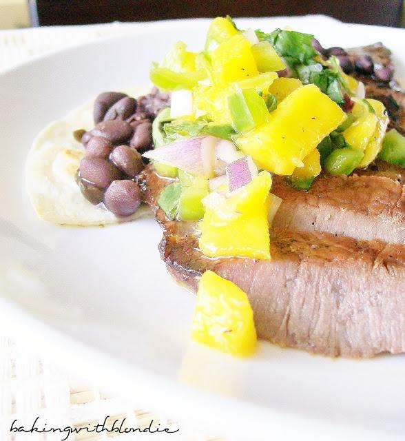 Skirt Steak Tostadas with Spicy Black Beans and Fresh Mango Salsa
