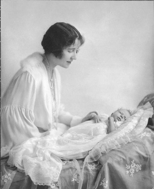 Photograph of Queen Elizabeth (born 1926), as a baby, with her mother Duchess of York (1900-2002), later Queen Elizabeth, the Queen Mother, 1926