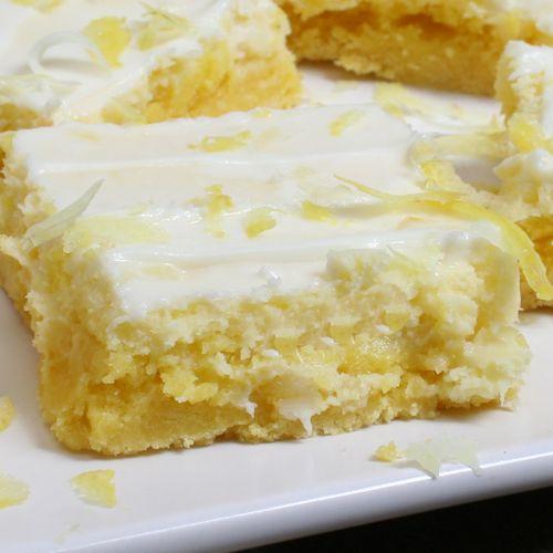 Cream Cheese Lemon Bars    - 1 box lemon cake mix  - 1/3 cup butter or margarine - softened  - 1 egg  - 8 ounces cream cheese - softened  - 1 cup powdered sugar  - 1/2 lemon - grated  - 2 tablespoons lemon juice or 1/2 fresh squeezed lemon  - 2 eggs  - 1 teaspoon vanilla