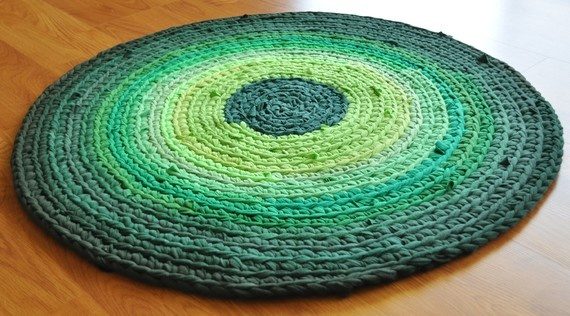 Rug crocheted from recycled t-shirts and sheets.