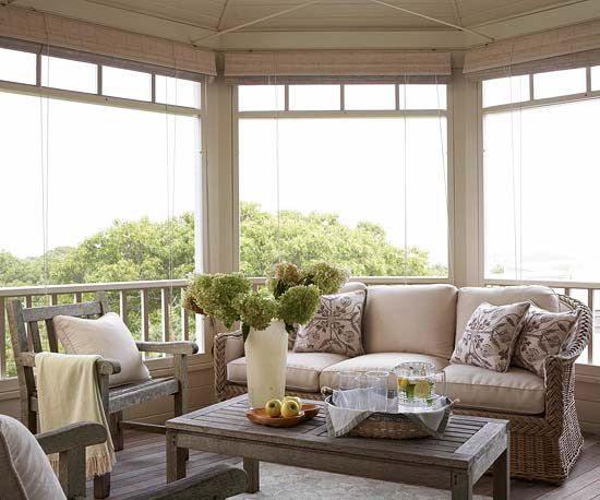 Casual Design - Contemporary touches, such as a neutral color palette, simple furniture designs, and matching cushions, can be cozy without distracting from a porch view. The angular geometry of this open porch's deck and railing emphasize the organic curves of the natural surroundings