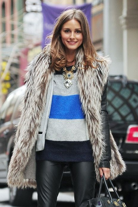 fur over sweater/statement necklace