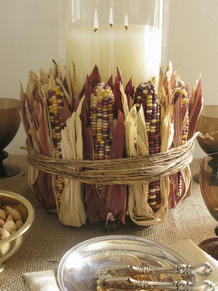 Large candle in a vase surrounded by Indian Corn - so festive!