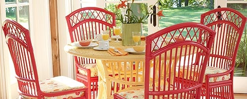 Love these rattan chairs from Maine Cottage - pretty cottage setting