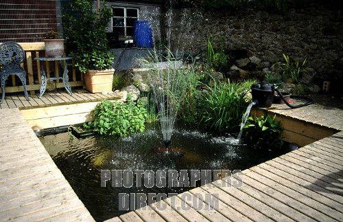 Koi pond built into deck outdoor spaces ideas pinterest for Koi pond deck