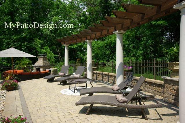 small pergola and wall along edge of patio paver patio