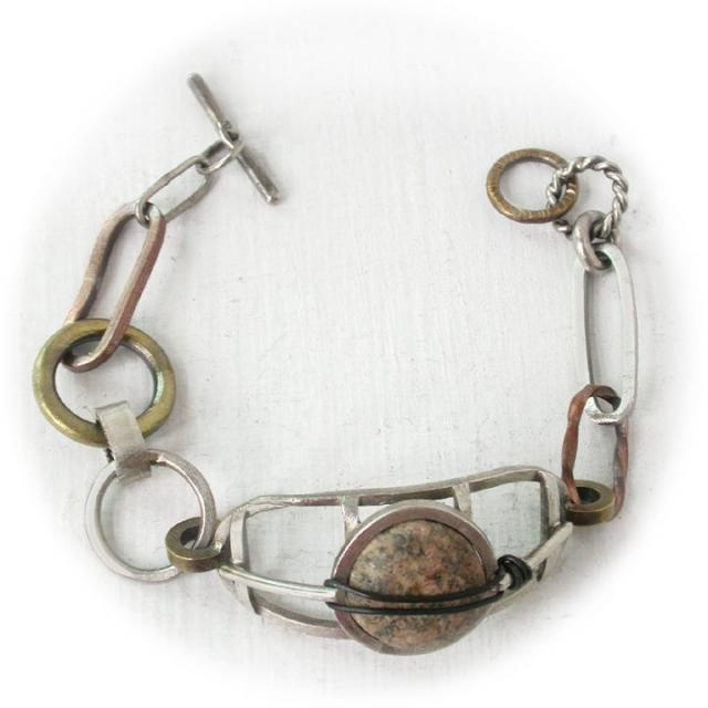 Okay people I am in love with this one of  a kind river stone bracelet pool you resources and get me this