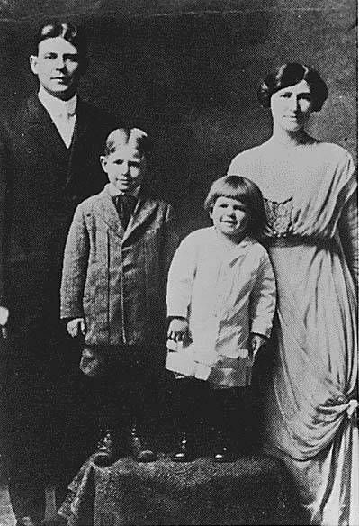 """Photograph of Ronald Reagan (with """"Dutch boy"""" haircut) Neil Reagan (brother) and Parents Jack and Nelle Reagan. (Circa 1914)"""