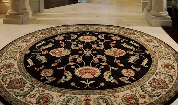 Circle area rug on stone floor entry. | Area Rugs | Pinterest