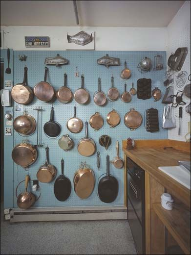 Julia Child's peg board and pots purchased between 1948 and 1952 in France. julias-pots-in-cambridge