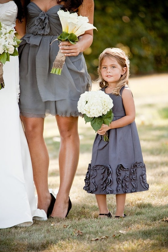 I like the idea of the flower girls in purple instead of white!