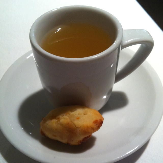 Neiman's chicken broth in a teacup with a cheese biscuit- exquisite!