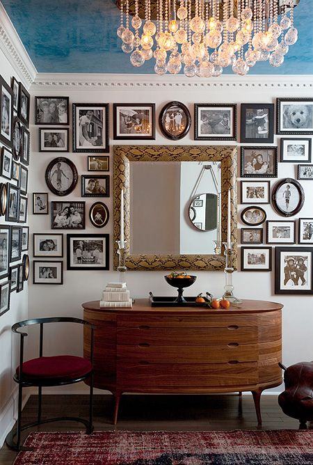 Black, miniature frames create an interesting gallery wall
