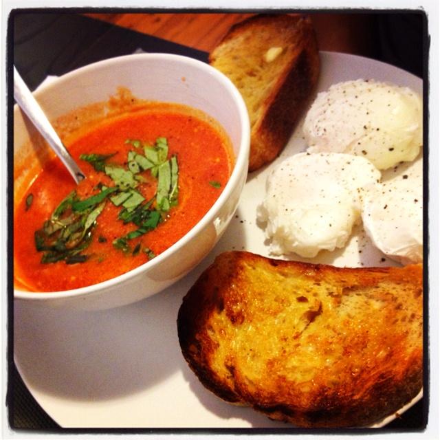 Homemade tomato soup, fresh basil, poached eggs & sourdough toast.