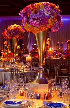 Unexpected yet showstopping, orange, purple, fuchsia & gold combine to create a palette infused with inspiration from across the globe. #flowers #centerpieces #globalweddings