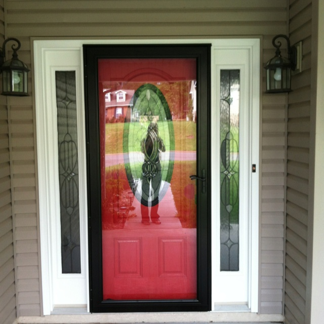 Red front door with black screen door doesn 39 t cover up for Front door with storm door