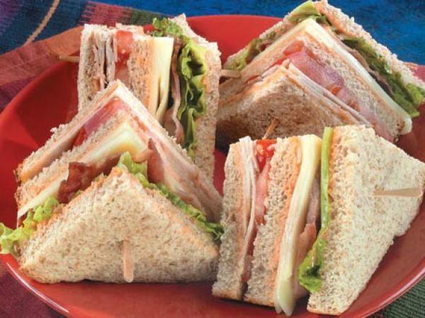 Turkey club sandwiches with the works recipe for Thanksgiving turkey sandwich recipe