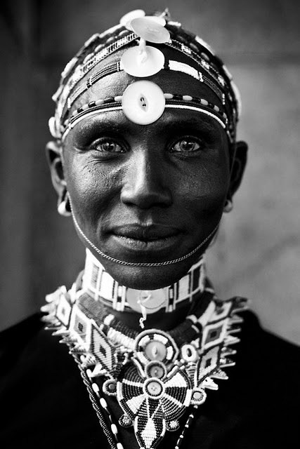 African woman. Love the emotion in her eyes.