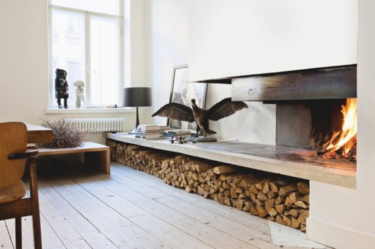 scandinavian fireplace log storage