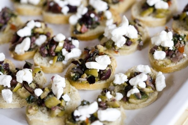 Olive Tapenade on Crostini with Goat Cheese. Catering Creations