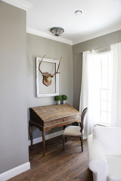 I like the antlers in the frame...farmhouse bedroom by Magnolia Homes, wall colour is intellectual gray by Sherwin Williams