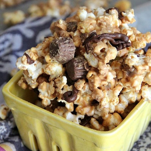 Peanut butter chocolate popcorn...add more Reese's cups! Make sure to ...