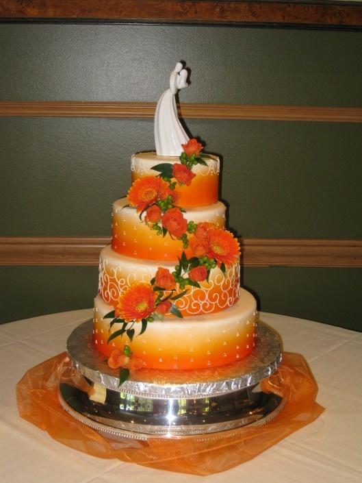 Beautiful Orange Wedding Cake With Gerber Daisies