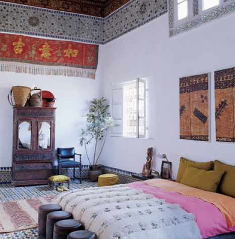love the Moroccan wedding blanket at the foot of the bed