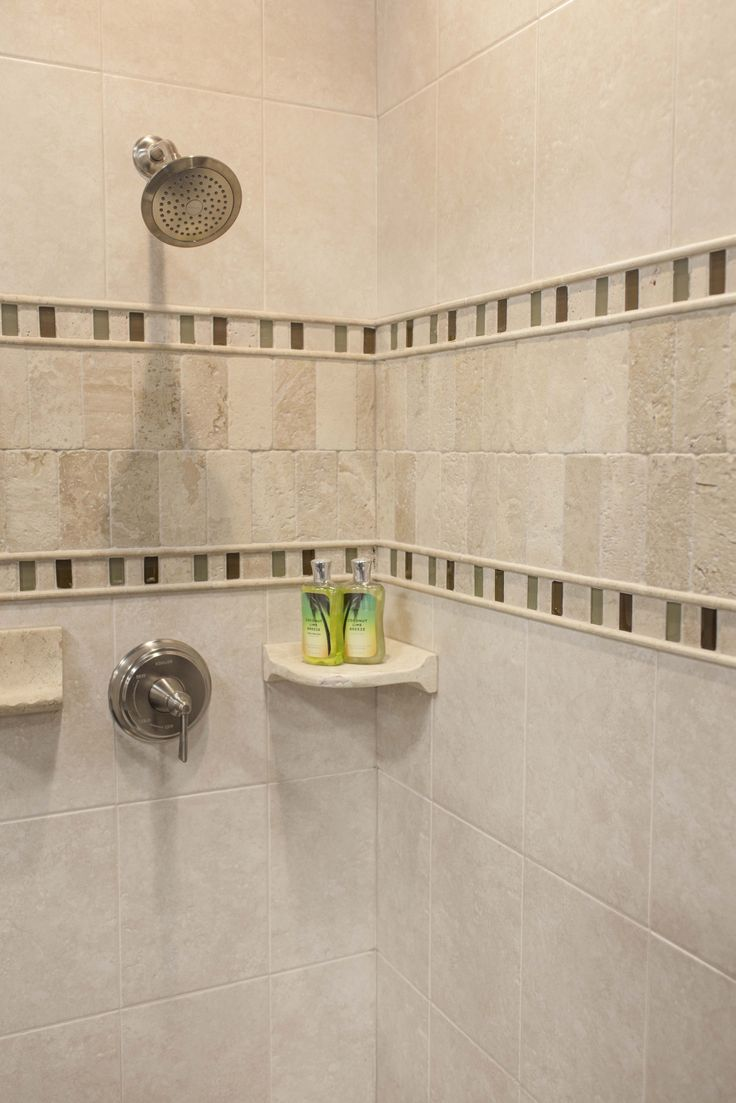 Travertine And Glass Shower Accents Make Ordinary Ceramic