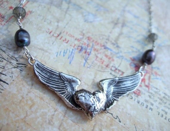 Silver Winged Heart Necklace, VIctorious Heart, Love Flies, Gift For Her in Reclaimed Silver. $95.00, via Etsy.