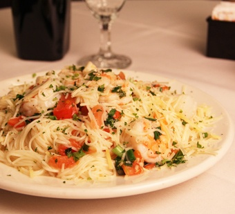 ... , Herbs and White Wine Butter Sauce served over Angel Hair Pasta