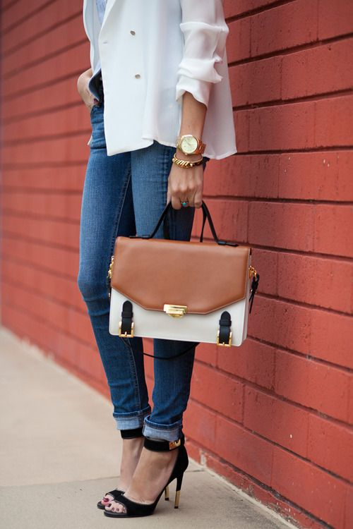 cuffed jeans and leather bag.