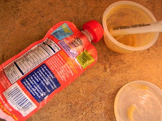 Refilling a baby food pouch.