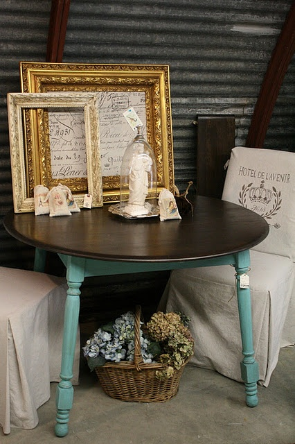 Nice paint job on vintage kitchen table with turquoise legs