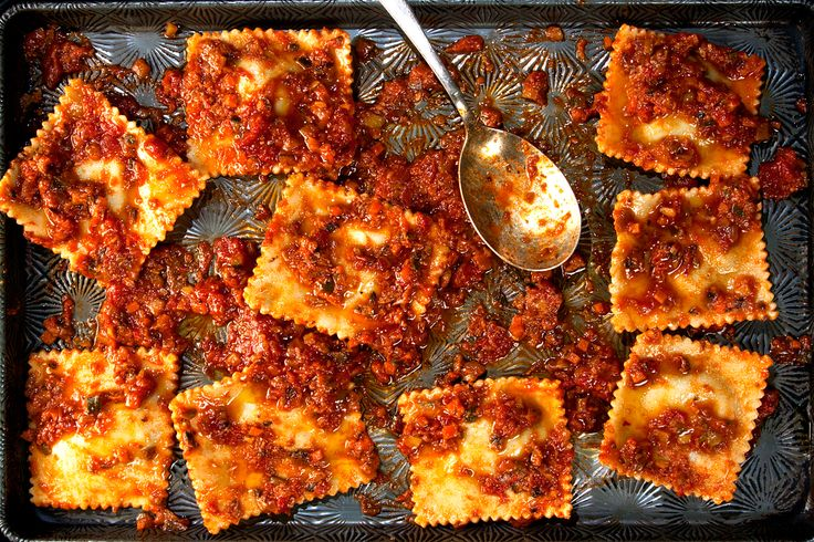 ravioli filled with spinach and cheese and topped with tangy tomato ...