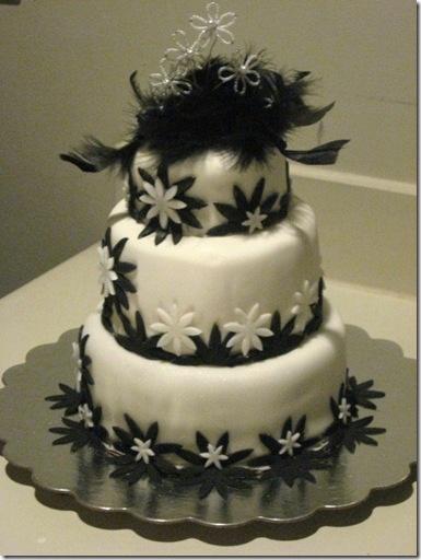 white fondant cakes with black spiderwebs