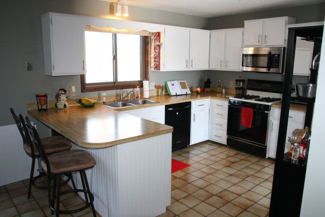 Kitchen cabinet makeover  painting cabinets from brown to white How